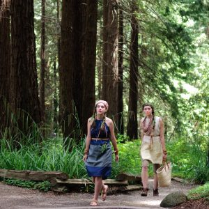 Two models in nature-inspired outfits walking in the Redwood Grove